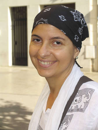 A cancer patient wearing a scarf to hide her baldness