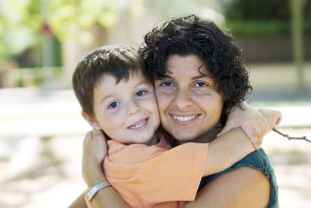 Happy family ( mom and son smiling toguether ) Stock Photo