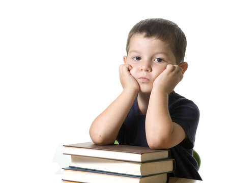 Adorable kid isolated on white semms to be very bored Stock Photo