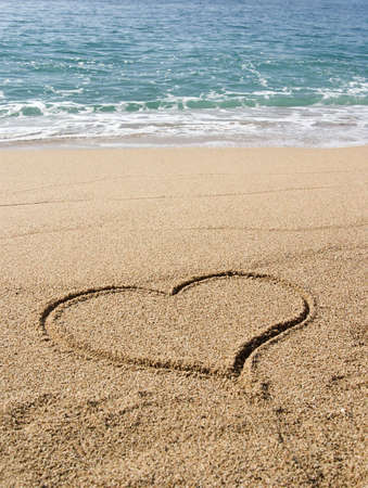 A heart drawn on the sand ( St. Valentines concept )