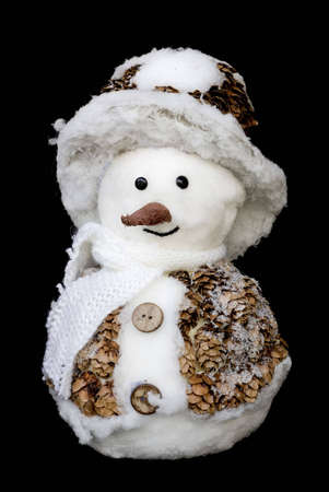 smiling snowman toy dressed in scarf and cap isolated on black background Stock Photo - 5681059