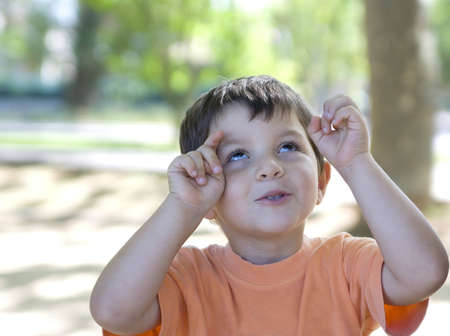 Adorable kid posing to the photographer ( funny gestures )