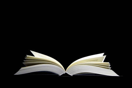 An open book on a black background Stock Photo
