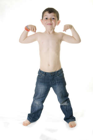 A Cheerful kid showing how strong he is   powerful concept   Stock Photo - 12867265