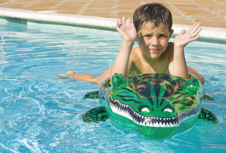 Summer and vacation concept   kid playing and enjoying the swimming pool   Stock Photo