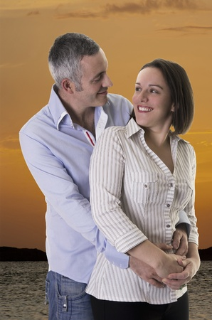 Happy caucassian couple   sunset background   Stock Photo