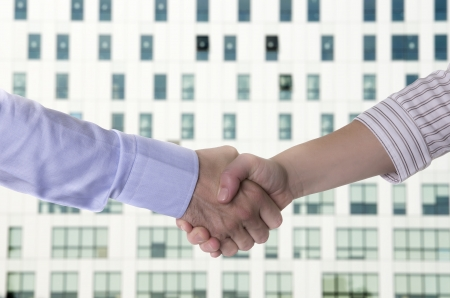 business handshake over a office building Stock Photo