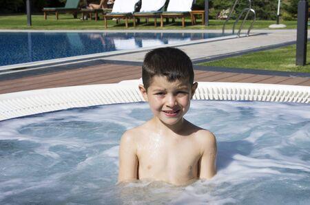 teenage boy in a hot tub Editorial