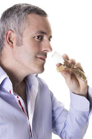 Man smelling a perfume   white background   Stock Photo