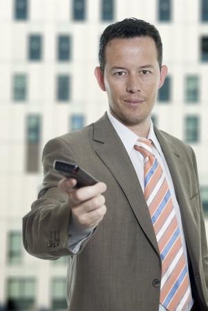 Business man with celullar photo
