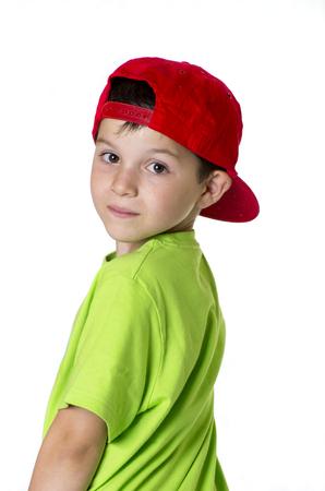 casquette: De vraies personnes (enfant portant un chapeau rouge Banque d'images