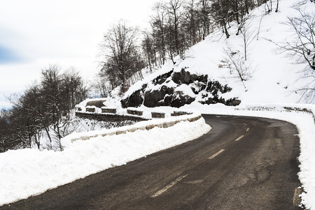 Cold day up in the mountains with a road Scene is covered in snow Stock Photo