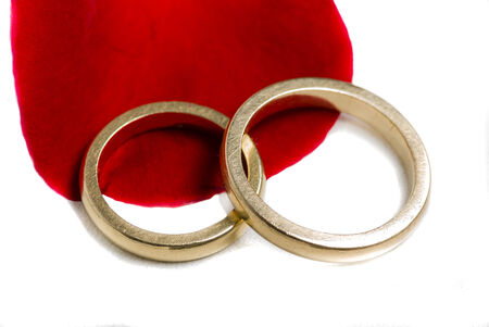 Real Golden wedding rings over a leave Stock Photo