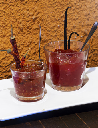 two tomato apple jam glass