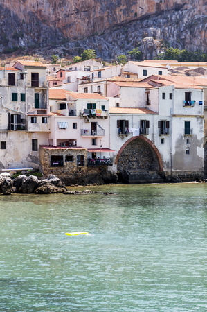 Cefalu city viewed from the sea Stock Photo