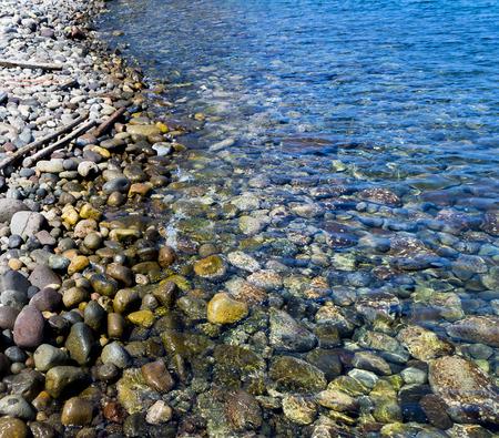 Colored pebbles at the coast of Mediterranean sea