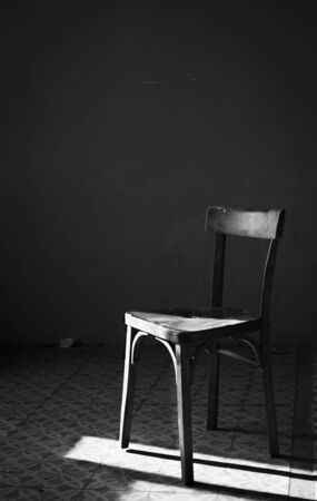 Vintage abandoned chair in black & white