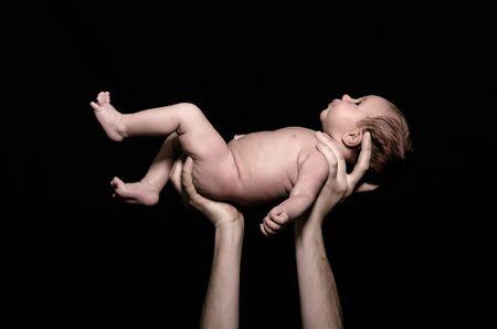 Newborn Held in Father's Hands