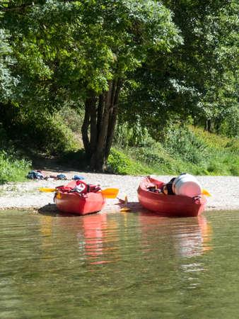 colorful kayaks ready to kayaking in spring river water.