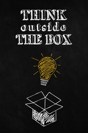 unconventional: A blackboard withthink Outside the Box concept, A slogan to motivate thinking differently, Concept design about freedom of mind and unconventional thinking outside the box Stock Photo