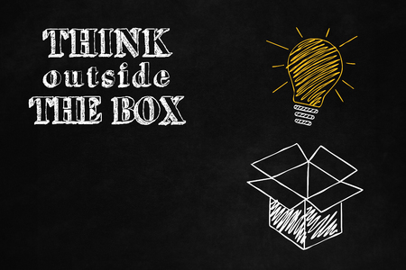 unconventional: Concept design about freedom of mind and unconventional thinking outside the box, A blackboard withthink Outside the Box concept, A slogan to motivate thinking differently Stock Photo