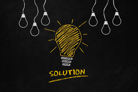A light bulb drawn on a blackboard indicates a solution, A conceptual design of a solutions idea, A Big Yellow Light Bulb with 6 smaller white light bulbs and Text Solution Banco de Imagens