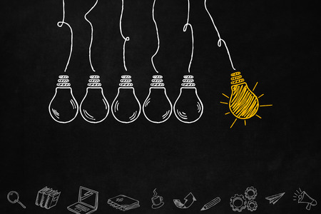 A creativity light bulb concept isolated on the blackboard. A series of light bulbs and creativity symbols with copyspace. Innovation concept with light bulbs and creative symbols