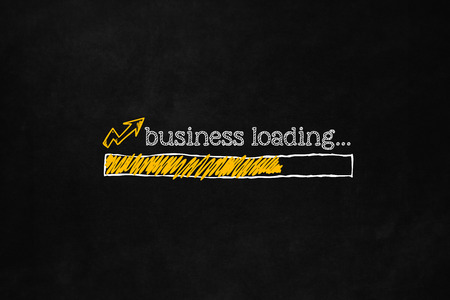 superiority: Business increase concept with copyspace suitable for business presentation. Progress bar indicates a growing business. A loading bar isolated on a blackboard indicate an improvement business.