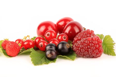 A selection of fresh berries isolated on white.  Stock Photo