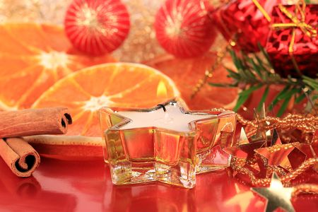 christmas scent: A Christmas still life with oranges and cinnamon