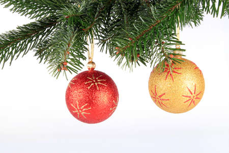 Christmas ball on fir tree branch isolated over white background Stock Photo
