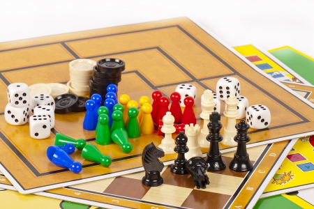 board games: Details of several colorful board games and game pieces.