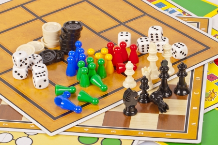 board game: Details of several colorful board games and game pieces.