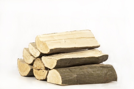 Small stack of split Beech firewood on a white background. Stock Photo