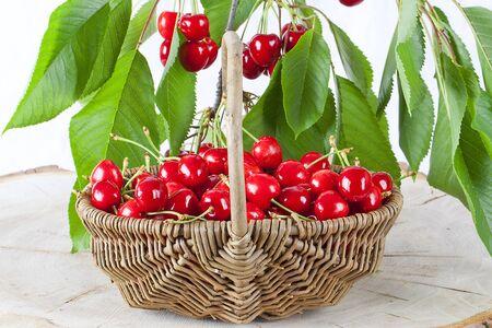 Red cherries in wicker basket.