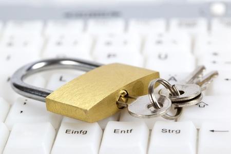 padlocked: Padlock and keys on computer keyboard; internet security concept.