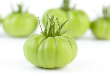 unripened: Group of Freshly Picked Green Tomatoes on White Stock Photo