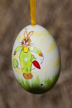 Hanging easter egg on brown background. Stock Photo - 15823528