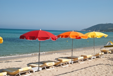 tropez: Beach loungers and parasol on the beach of St  Tropez  Stock Photo
