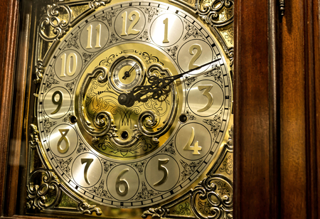 An old antique mechanical grandfather clock Stock Photo