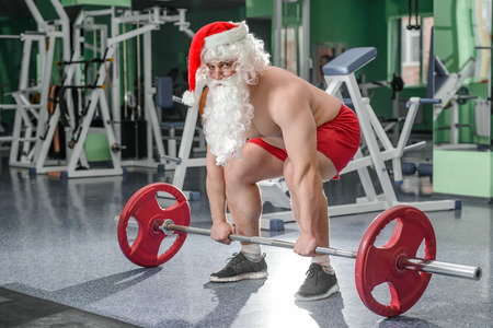 Bodybuilder Santa on workout in a gym