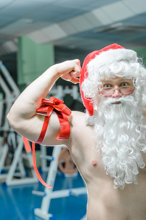 Santa shows you Muscles as a gift.
