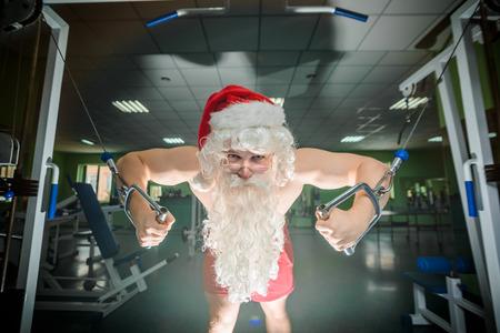 Bodybuilder Santa on workout in a gym