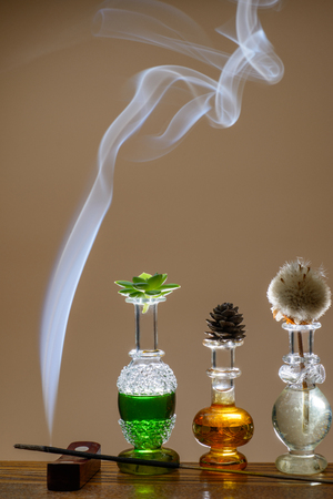 dacorated: Small bottles of perfume dacorated with smoke from aromatic sticks
