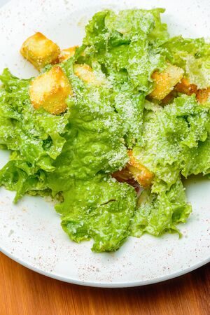 croutons: Green salad with croutons, cheese and chicken