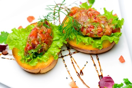 appetizing: Two appetizing toastst with vegetable mix on them Stockfoto