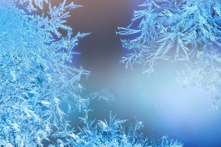 Frozen windows in winter time with frost decorations