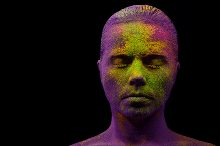 alien women: Young cheerful woman fully covered with holi paint powder Stock Photo