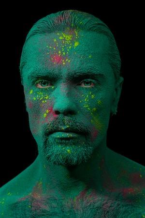 fake eyelashes: Portrait of man fully covered with holi paint powder Stock Photo