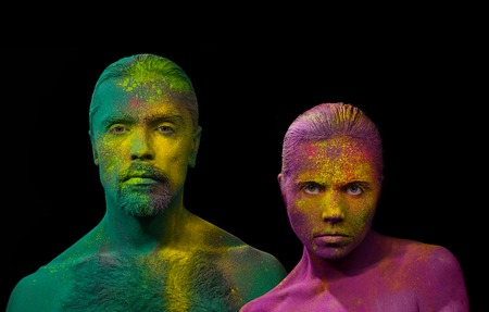 Young man and woman fully covered with holi paint powder